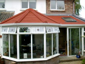 A solid conservatory roof, which replaced a traditional glass roof