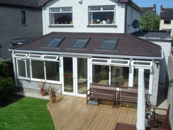Solid conservatory roof in place